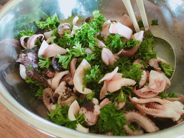 My mom prepared a delicious salad with squid and octopus
