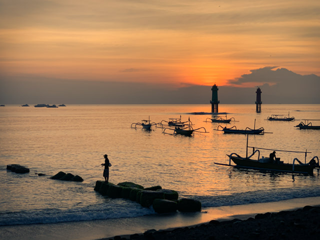 The sun is about to rise over Sanur Harbor