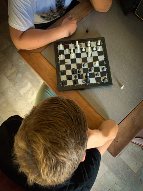 I am enjoying a game of chess with my dad