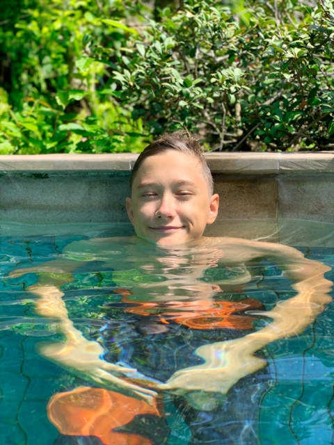 I'm relaxing in our house-owner's pool